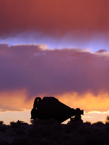 The sun sets behind old mining equipment at the Tonopah Historic Mining Park.