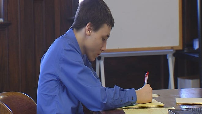 Cody Metzker-Madsen has drawn on a yellow legal notepad throughout his first-degree murder trial