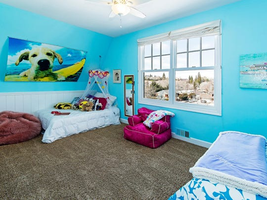 """The upper story of the """"barn"""" section of 866 Skyline Blvd. incorporates two children's bedrooms and a workout room."""