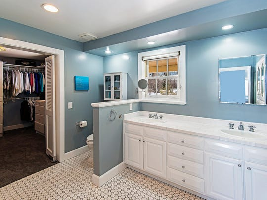 In the master suite of 866 Skyline Blvd., a fitted dressing room opens from the large master bath.