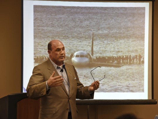 FILE- In this Nov. 16, 2014, file photo, Hudson River plane crash survivor Dave Sanderson speaks at the Franchise Expo in Secaucus, N.J. Sanderson was the last passenger to exit US Airways Flight 1549 after its emergency landing in the Hudson River in January 2009. (Chris Pedota/The Record via AP, File)