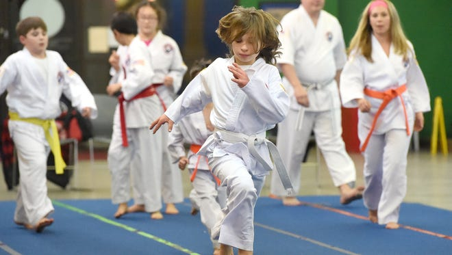 Ten-year-old Clay Stockman, a white belt in Tae Kwon Do, runs the length of the mat during a class at the Dong's Martial Arts studio in Staunton on Jan. 16, 2017. Clay has since advanced to the rank of yellow belt.