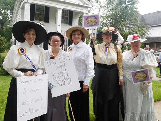 From left, Denise Lacey-Corcoran, Lydia Corcoran  Diane Lacey, Bonnie Baker-Duff and JoAnne Thornton dress in early twentieth century attire in attendance of the ceremony for a historic marker for Elizabeth Browne Chatfield, private secretary to Susan B. Anthony from 1868-1871. Friday's ceremony included the dedicating of a historic marker and remarks by local historians and politicians.