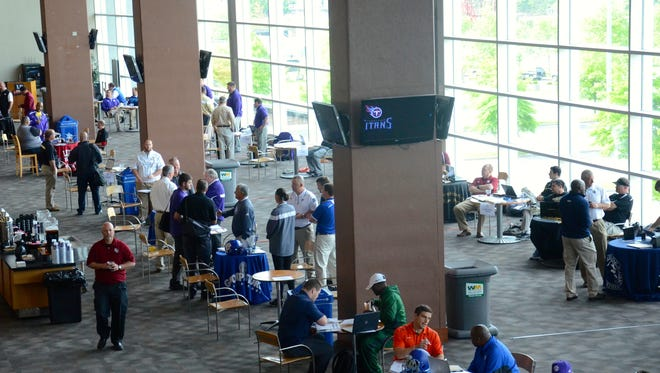 Around 120 high school and college football coaches attended the inaugural Tennessee Titans and Tennessee Football Coaches Association High School Football Recruiting Fair.