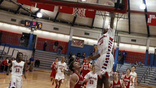 Montgomery Central's Trey Spencer went for the slam on a fast break against the Jo Byrns Red Devils during a game two years ago.