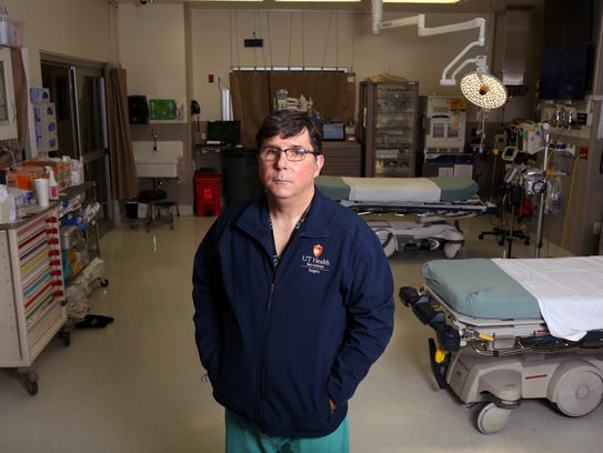 Surgeon Dr. Ronald M. Stewart, Chair of the Department