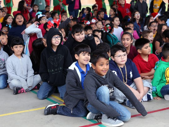 Students await the arrival of Santa Claus for their