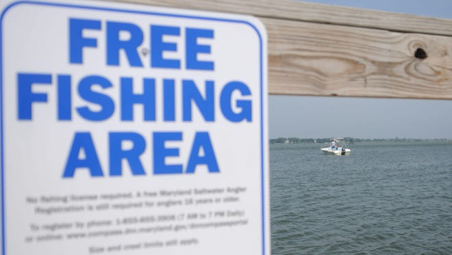 A boat floats in the Ocean City Inlet near the free fishing spot between Second and Fourth streets.
