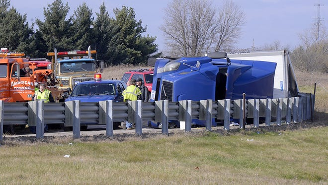 Police, fire and other personnel on the scene of a semitruck rollover near I-69 and US 127 near DeWitt Wednesday 11/5/2014.    (Rod Sanford | Lansing State Journal)