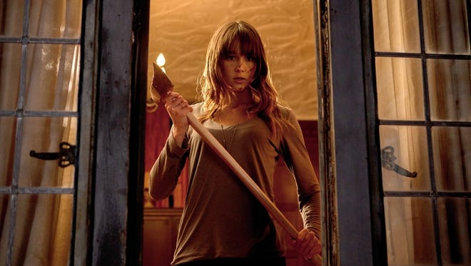 Sharni Vinson takes on violent, masked home invaders in the new horror film 'You're Next.'