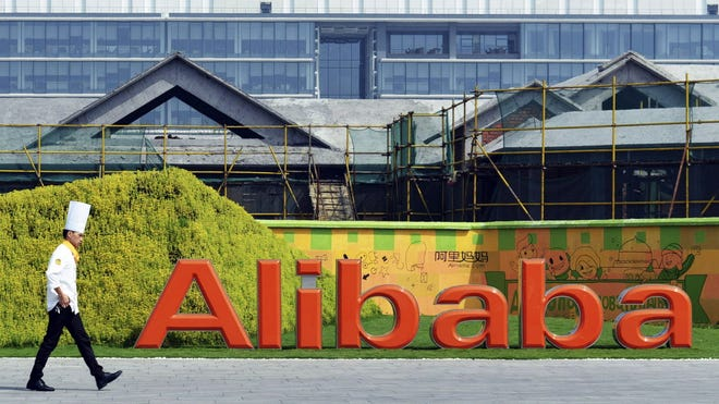 A chef walks in the headquarter campus of Alibaba Group in Hangzhou in eastern China's Zhejiang province. Control over Alibaba Group will stay in the hands of founder Jack Ma and other company veterans after the Chinese e-commerce giant goes public on the New York Stock Exchange in a record busting share sale.