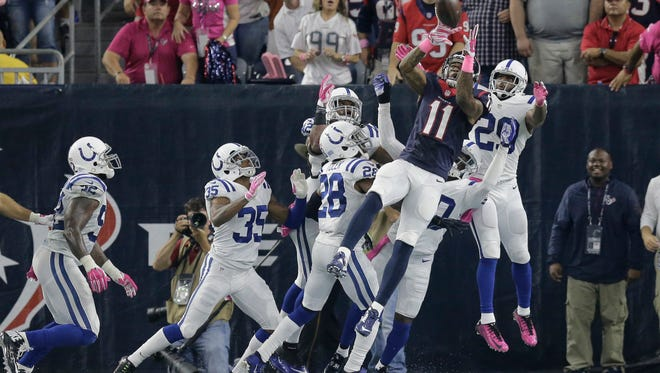 Houston Texans' Jaelen Strong (11) pulls is a pass for a touchdown against the Indianapolis Colts to the the first half of an NFL football game Thursday, Oct. 8, 2015, in Houston.