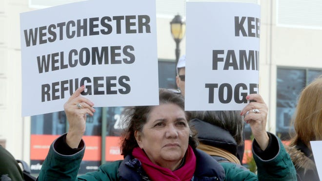 Rev. Elissa Leona of Carmel was among several hundred people who attended a unity rally in November to support resettlement of refugees.