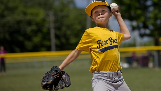 Carter Dietrich, 9, throws the ball to home while competing in throwing with his Fort Gratiot teammates