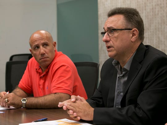 Edit board with JCP&L executives about the proposed transmission line from Red Bank to Aberdeen. Scott Humphrys (left) transmission siting lead and Anthony Hurley, VP of Operations—June 6, 2016 -Neptune, NJ.-Staff photographer/Bob Bielk/Asbury Park Press