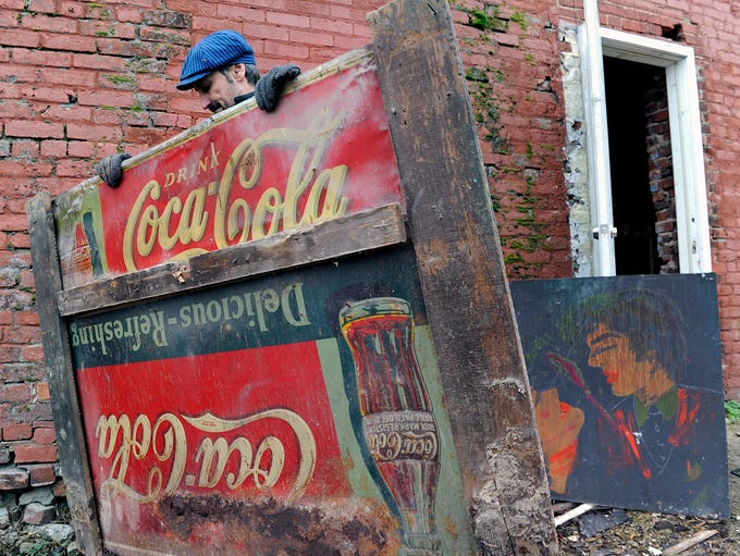 Mike Wolfe found old Coca-Cola signs and artwork inside