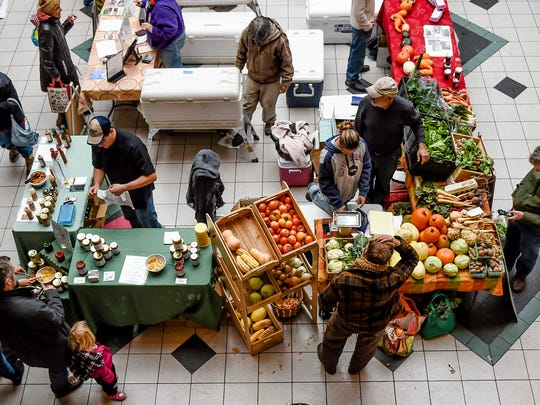 People shop at a Northern Colorado Food Cluster winter market at Opera Galleria in downtown Fort Collins in this Nov. 15 file photo.