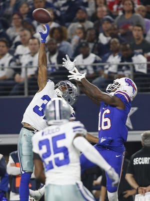 Robert Foster, then with the Bills, competes for a pass with cornerback Byron Jones, then with the Cowboys. Both are Dolphins now.
