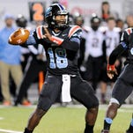 Zachary quarterback Lindsey Scott drops back to pass against Parkway.