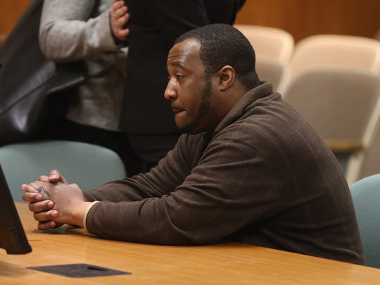Silvon Simmons reacts to having the conviction of shooting at a Rochester police officer reversed as the court room clears.
