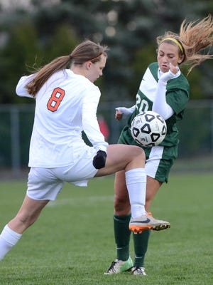 Novi's Jessica Halmaghi (right) battles with Northville's Tara Palowski for control of the ball during their KLAA Central Division scoreless draw.