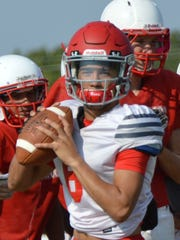 Sweetwater senior quarterback Chris Thompson, shown here throwing a pass during practice on Tuesday, has quickly adjusted to the new offensive scheme implemented by first-year coach Ben McGehee.