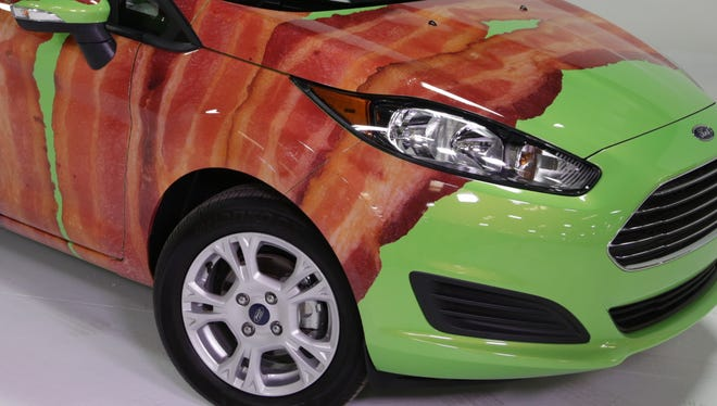 Ford is wrapping the Fiesta in bacon --a vinyl wrap anyway