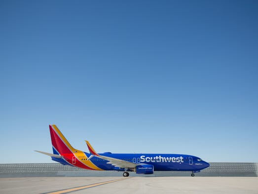 """These photos released by Southwest show off its new """"Heart"""" aircraft livery as well as its new logo and branding for its airport locations."""
