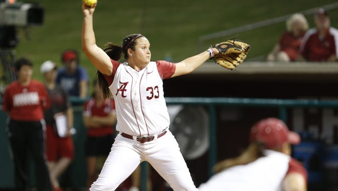 Jackie Traina pitched a one-hitter in helping Alabama knock off defending national champion Oklahoma 6-2 on Thursday night.