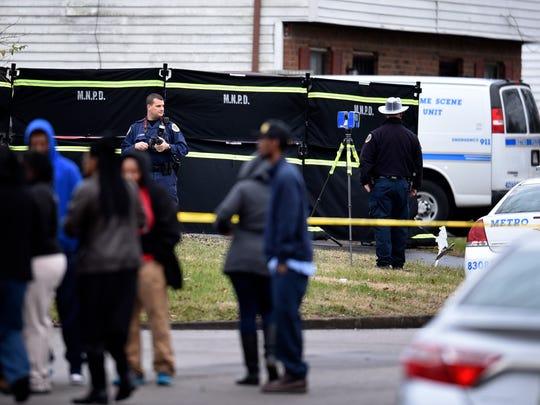 Police investigate a home on Vista Lane where Andre Lamonte Parker Sr., Jacqueline Parker and Shanel Bowen were found dead.