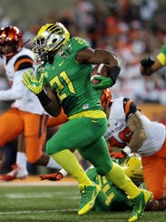 Freshman Royce Freeman rushed for 1,299 yards and 16