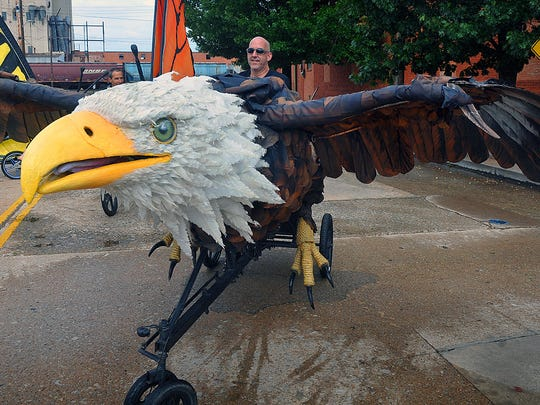 David Russ pilots the impressive eagle bike, a pedal-powered masterpiece of The Bike Zoo from Austin. Russ used his talents as an artist and puppeteer to give the creation six different movements and stunning attention to detail.