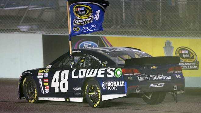 Jimmie Johnson celebrates after winning the 2013 NASCAR championship at Homestead-Miami Speedway. It was the sixth championship of Johnson's career.