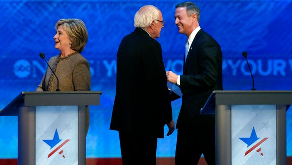 Bernie Sanders, center, speaks to Martin OíMalley,