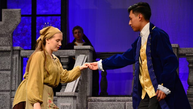 """Emma Snodgrass as Cinderella and Isai Matias as Prince Charming rehearse a scene for Cumberland Regional High School's spring musical """"Cinderella,"""" which will be presented at 7 p.m. March 23 and 24 and 1 and 7 p.m. March 25 in the school's Performing Arts Center at 90 Silver Lake Road, Seabrook. Tickets, available at the door, are $12 for adults and $8 for children and students with identification. For information, call (856) 451-9400 or visit www.crhsd.org."""