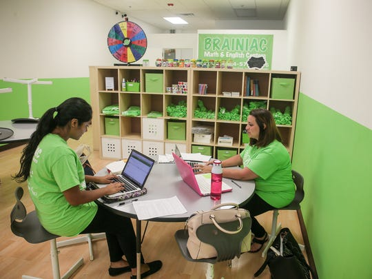 Ankita Satpathy of Monroe, left, a mentor, and Rachel Rose of Matawan, assistant to the director, work at Brianiac, a new tutoring center for young children in Old Bridge, on June 29, 2016.