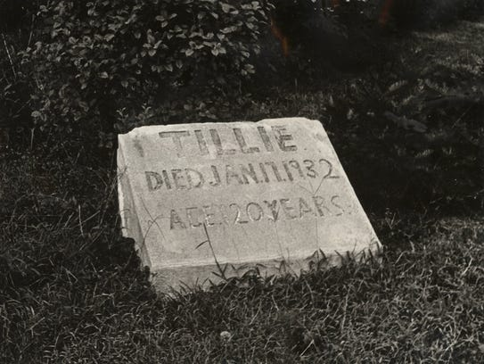 SEPTEMBER 17, 1972: A simple sandstone marker in front