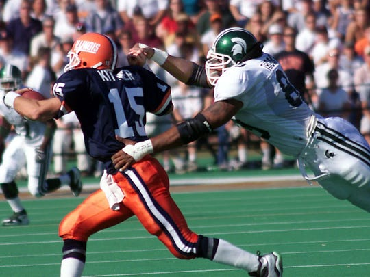 MSU's Hubert Thompson flies though the air to catch Kurt Kittner for a QB sack in the first half of a 1999 game.