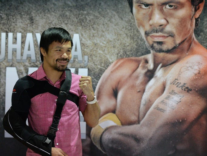 Manny Pacquiao poses for photo after a press conference
