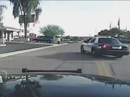 A Marana police dashboard camera captures another officer running into a suspect  with his car.