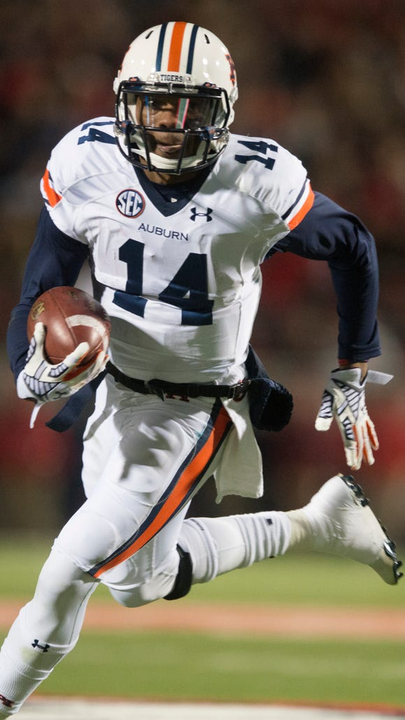 Auburn quarterback Nick Marshall (14) runs downfield during the NCAA football game at University of Mississippi in Oxford, Miss., on Saturday, Nov. 1, 2014. Auburn defeated Mississippi 35-31