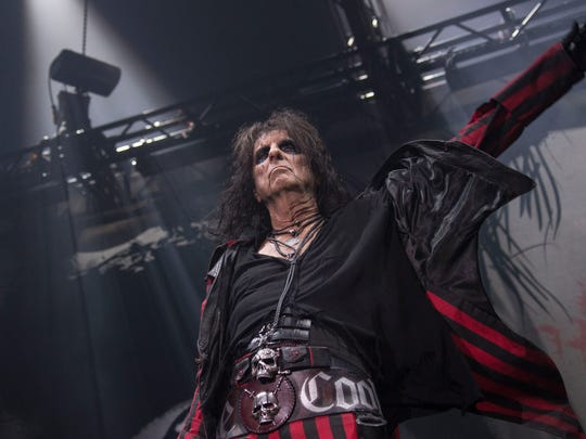 Alice Cooper performs on stage at Wembley Arena in London.