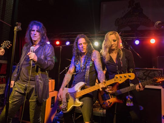 Alice Cooper performs with members of his band at Cooper'stown