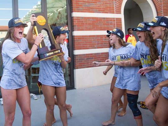 Amanda Longan, left, celebrates with her teammates