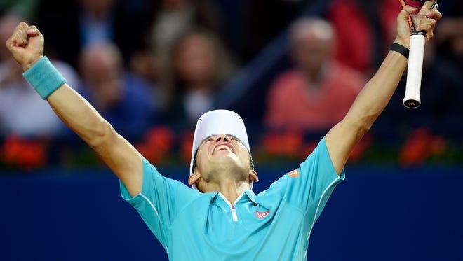 Kei Nishikori of Japan celebrates after winning  the Barcelona Open tennis tournament.