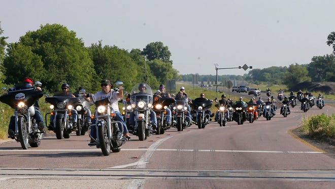 """About 50 motorcycle riders parade down loop 340 during  an """"All for 1"""" rally throughout Waco, Texas.. Organizers, who have called the event a peaceful, silent protest, will gather in front of the McLennan County Courthouse to protest what they say is the violation of rights of many bikers who were arrested May 17 at Twin Peaks just for being at the scene of the shootout."""