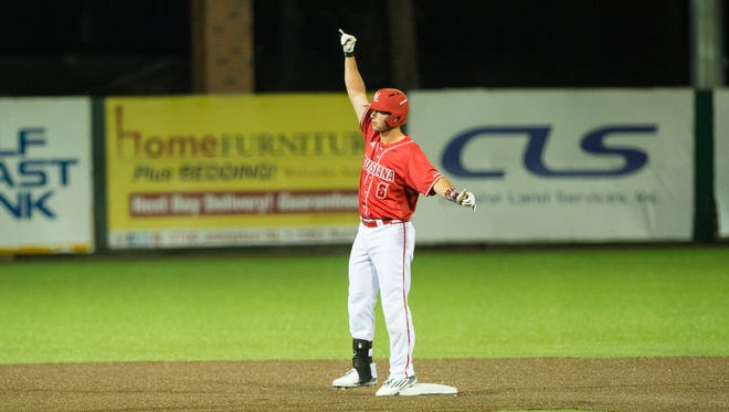Nick Thurman throws the UL signs to his teammates after hitting a standup double in Friday's 8-0 win over Sacred Heart.