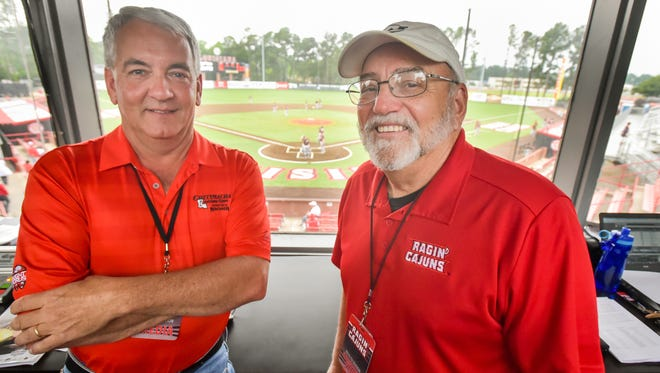 Official scorer Dan McDonald (left) and scoreboard operator Guy Rials in the UL baseball press box, which will be demolished as part of stadium renovations next month.