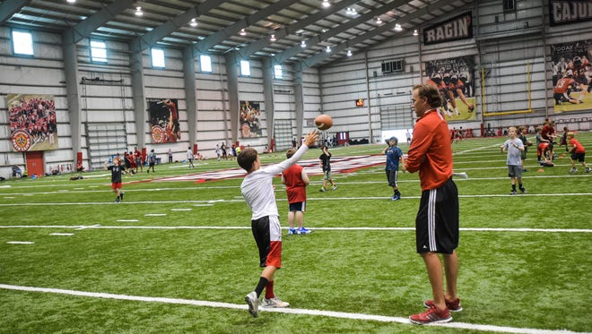 Offensive GA for the Cajuns, Brady Thomas providing campers with instructions at the  Cajuns youth football camp.