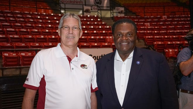 ULM athletic director Nick Floyd posses for a photo with Monroe Mayor Jamie Mayo. Floyd was hired as athletic director in June 2017 after 16 years in various athletic administration roles at East Carolina.